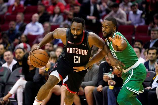 Houston Rockets' James Harden (13) drives toward the basket as Boston Celtics' Kemba Walker defends during the first half of an NBA basketball game Tuesday, Feb. 11, 2020, in Houston. (AP Photo/David J. Phillip)