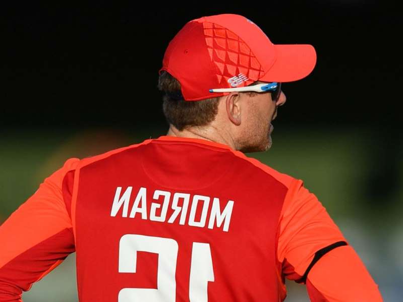 a baseball player wearing a red hat: Morgan expects his England team to bounce back quickly after defeat in the series opener