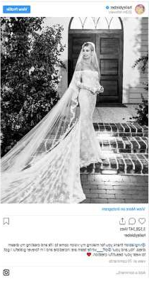 a person in a dress: From Ellie Goulding to Leona Lewis, many of our favourite celebrities have tied the knot in 2019, and as you would expect, they had the most beautiful wedding dresses from prestigious designers including Chloé, Louis Vuitton and Zac Posen. Each bride reflected her own personal style in her choice of dress – from Rachel Riley's pink mini dress to Sabrina Dhowre's dreamy Vera Wang gown. Take a look through the gallery to see some of the most memorable celebrity wedding dresses of 2019…  Hailey Bieber  For her wedding to Justin Bieber in September, Hailey looked every inch the model bride in her gorgeous off-the-shoulder long-sleeved lace gown designed especially for her by Virgil Albloh for Off-White. Adding an unexpected and modern touch to her bespoke wedding dress was her statement veil, which was embroidered with the words