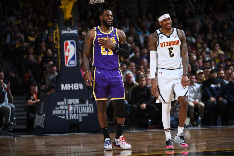 DENVER, CO - FEBRUARY 12: Torrey Craig #3 of the Denver Nuggets and LeBron James #23 of the Los Angeles Lakers smile during the game on February 12, 2020 at the Pepsi Center in Denver, Colorado. NOTE TO USER: User expressly acknowledges and agrees that, by downloading and/or using this Photograph, user is consenting to the terms and conditions of the Getty Images License Agreement. Mandatory Copyright Notice: Copyright 2020 NBAE (Photo by Garrett Ellwood/NBAE via Getty Images)
