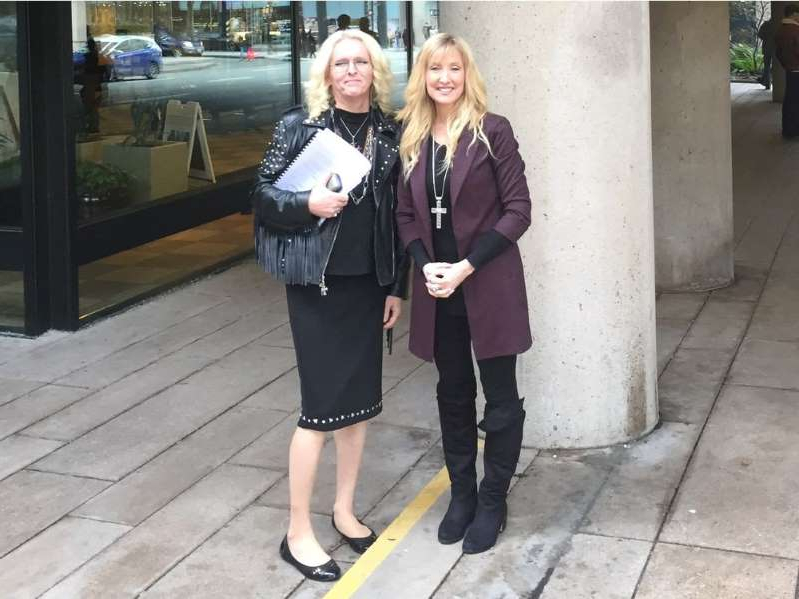 Laura-Lynn Tyler Thompson standing on a sidewalk: Former People's Party of Canada candidate Laura-Lynn Tyler Thompson, left, and transgender activist Jenn Smith outside B.C. Supreme Court in Vancouver on Wednesday.