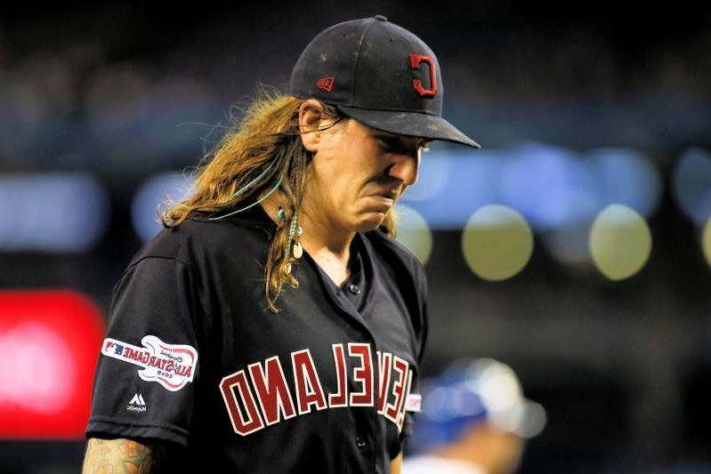 a baseball player wearing a red hat: Indians starting pitcher Mike Clevinger being on the shelf for however long is a tough blow for the team.