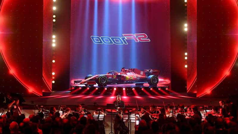 a group of people on a stage in front of a crowd: Ferrari faces legal action over advertising