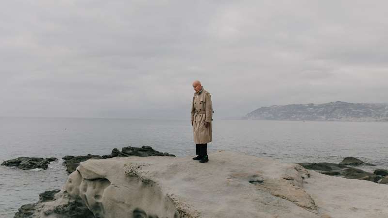 a person standing next to a body of water: The French writer Gabriel Matzneff in the Italian Riviera this month. He has long boasted of his sexual encounters with underage partners.