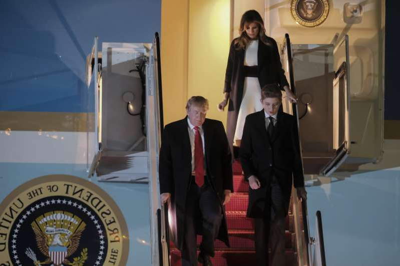 Barron Trump standing in front of a mirror posing for the camera: President Trump and his family on his way to Mar-a-Lago earlier this month. He is slated to attend a fundraiser near his Palm Beach club on Saturday — the most expensive since he became president.