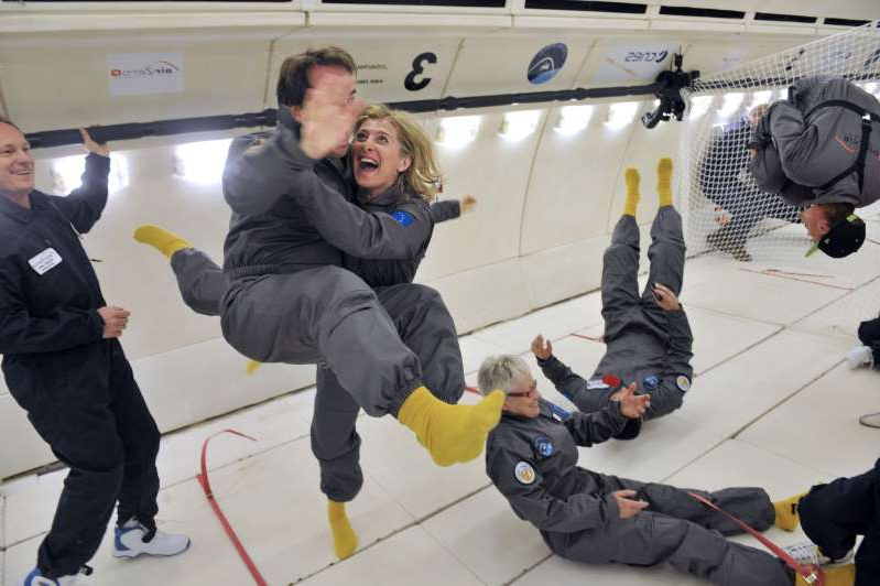 Civilian passengers of the Airbus A330 Zero-G, who are not astronauts nor scientists, enjoy the weightlessness, on March 15, 2013, during the first zero gravity flight for paying passengers in Europe. All boarding cards, costing 6,000 euros, were sold for the years 2013 and 2014. Zero gravity flights for paying passengers have already taken place in the United States and Russia. The zero-gravity of space is simulated by flying a series of parabolic flight maneuvers that counter the forces of gravity and allow astronauts and cosmonauts to learn how to accomplish tasks with no gravity. AFP PHOTO / MEHDI FEDOUACH        (Photo credit should read MEHDI FEDOUACH/AFP/Getty Images)