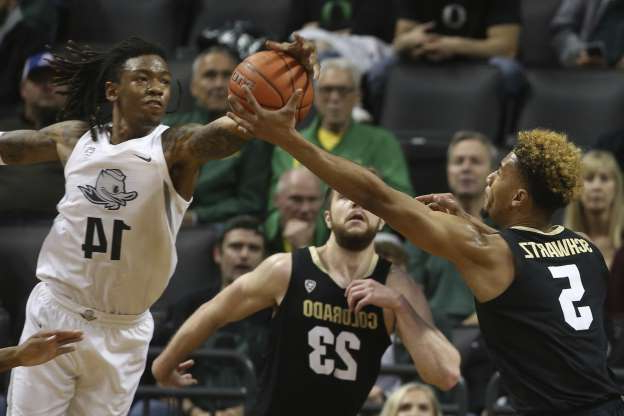 Colorado's D'Shawn Schwartz, left, and Lucas Siewart, center, compete against Oregon's C.J. Walker, right, for a rebound during the second half of an NCAA college basketball game in Eugene, Ore., Thursday, Feb. 13, 2020. (AP Photo/Chris Pietsch)