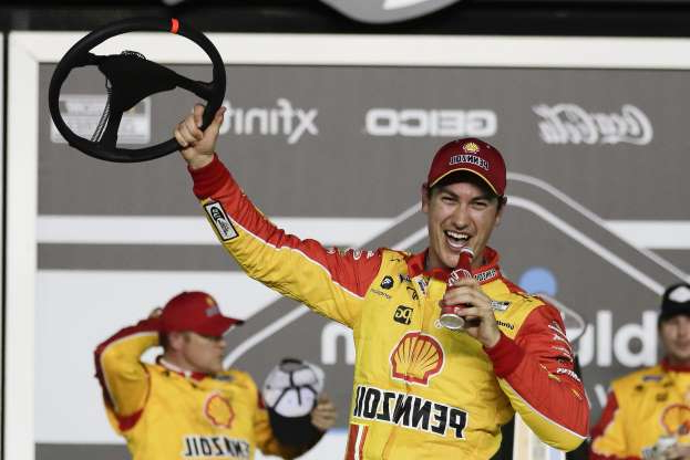 Joey Logano celebrates in Victory Lane after winning the first of the two NASCAR Daytona 500 qualifying auto races at Daytona International Speedway, Thursday, Feb. 13, 2020, in Daytona Beach, Fla. (AP Photo/John Raoux)