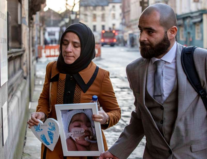 Karwan (left) and Shokhan Ali, the parents of three-month-old Midrar Ali, arrives ahead of a hearing at The Family Court in Preston