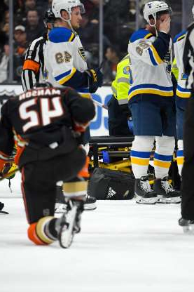 Slide 1 of 111: Feb. 11: St. Louis and Anaheim players show their concern after Blues defenseman Jay Bouwmeester collapsed on the bench.