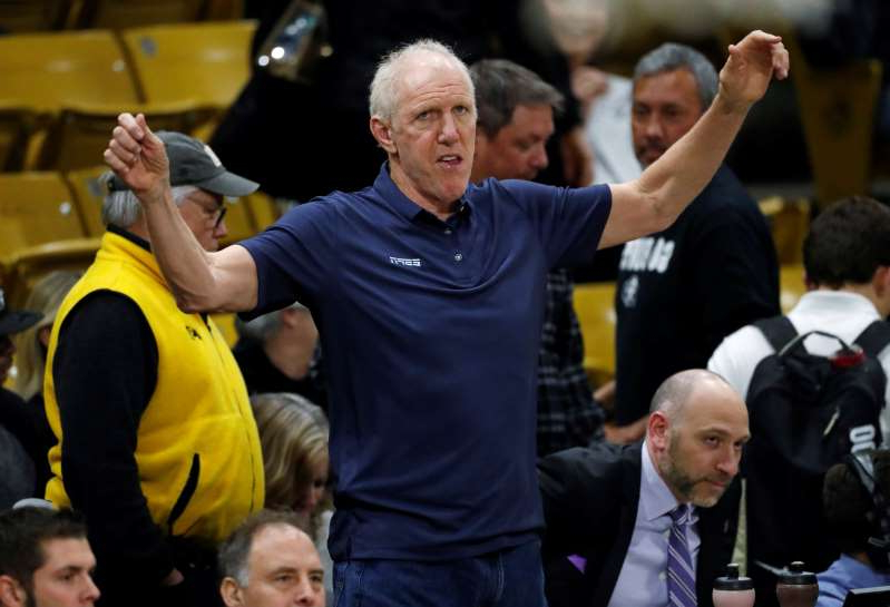 Television analyst Bill Walton stretches before the first half of an NCAA college basketball game between Oregon and Colorado Thursday, Jan. 2, 2020, in Boulder, Colo. (AP Photo/David Zalubowski)