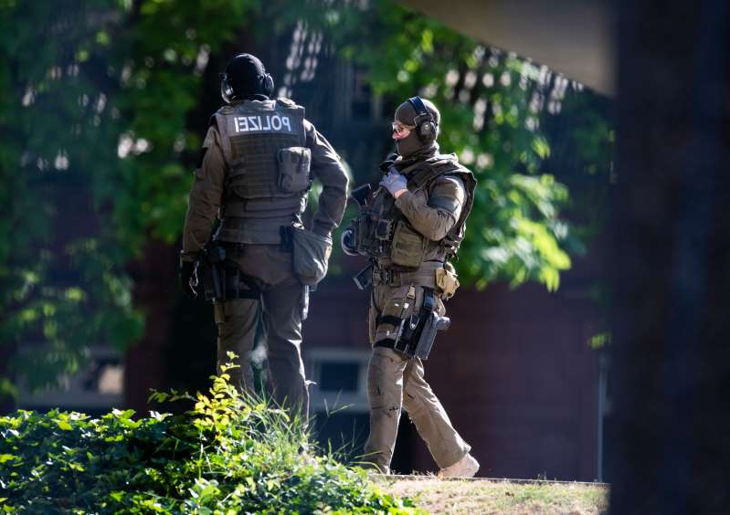 01 July 2019, Baden-Wuerttemberg, Karlsruhe: Armed policemen are standing on the grounds of the Federal Court of Justice. Stephan E., suspect in the case of the murdered Kassel District President Walter Lübcke, is brought to an investigating judge at the Federal Supreme Court (BGH). Photo: Silas Stein/dpa (Photo by Silas Stein/picture alliance via Getty Images)