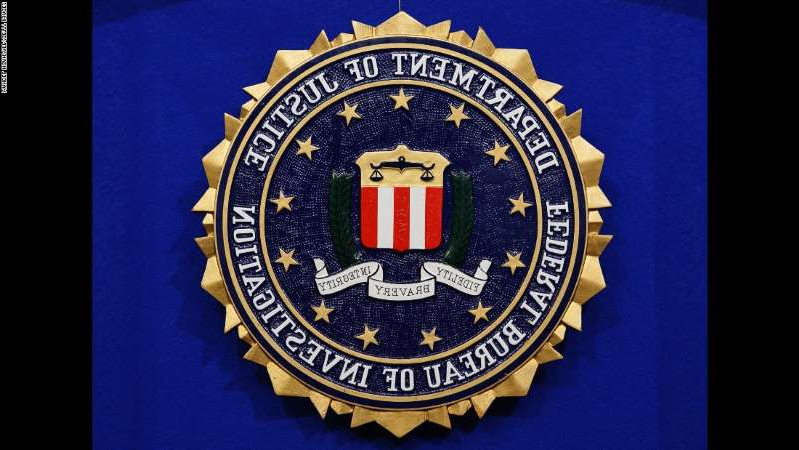 a black sign with white text: The FBI has a specialized Art Crime Team that handles art and cultural property crime cases.