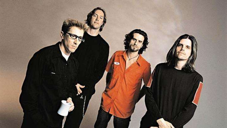 Adam Jones et al. posing for the camera: The band Tool: (from left) Adam Jones, Justin Chancellor, Danny Carey and Maynard James Keenan.