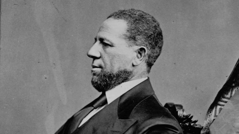 Hiram Rhodes Revels wearing a suit and tie: Senator Hiram Rhodes Revels.