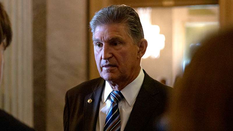 Joe Manchin wearing a suit and tie: Senate Democrats pressure Trump to drop ObamaCare lawsuit