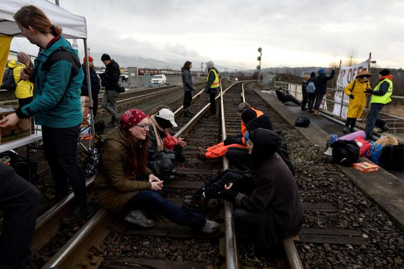 Protesters against the Coastal GasLink pipeline block the eastbound tracks on the CP rail bridge in Port Coquitlam, British Columbia, Canada February 13, 2020.   REUTERS/Jennifer Gauthier