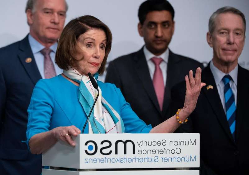 Stephen F. Lynch, Ro Khanna, Nancy Pelosi, Bill Keating standing next to a man in a suit and tie: US Speaker of the House Nancy Pelosi airs her concerns about China's Huawei at a press conference Sunday at the Munich Security Conference. Sven Hoppe/picture alliance via Getty Images