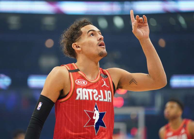 a person holding a ball: Feb 16, 2020; Chicago, Illinois, USA; Team Giannis guard Trae Young of the Atlanta Hawks reacts in the first quarter during the 2020 NBA All Star Game at United Center. Mandatory Credit: Kyle Terada-USA TODAY Sports