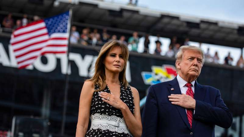 Donald Trump, Melania Trump are posing for a picture: President Trump and Melania Trump at the Daytona International Speedway in Florida on Sunday.
