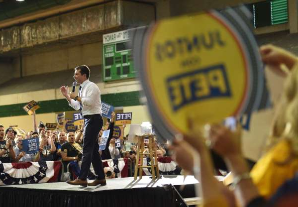 a group of people on a stage: Former South Bend, Ind., mayor Pete Buttigieg speaks at a Sunday campaign event in Las Vegas. Nevada's caucuses wrap up Saturday.