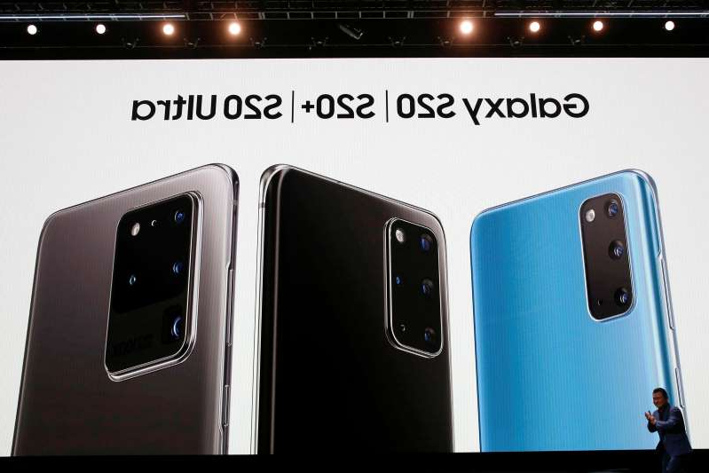 a screen shot of a smart phone: FILE PHOTO: TM Roh of Samsung Electronics unveils the Galaxy S20, S20+ and S20 Ultra smartphones during Samsung Galaxy Unpacked 2020 in San Francisco