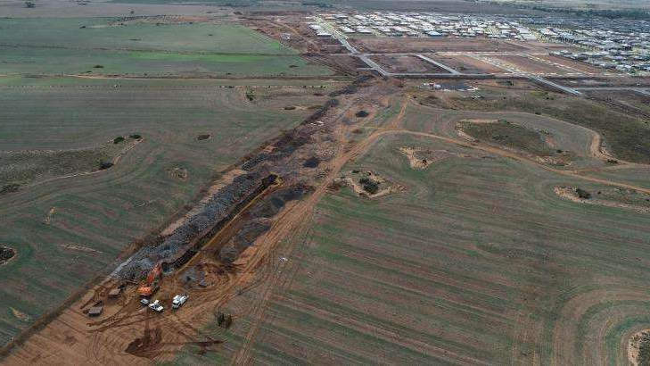 a view of a beach: The Wyndham Vale rail stabling yard now under construction is just north of housing estates.