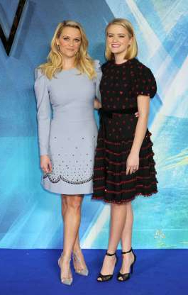 Reese Witherspoon standing posing for the camera: Reese Witherspoon and Ava Phillippe attend the