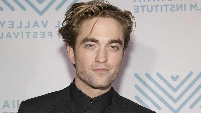 Robert Pattinson wearing a suit and tie