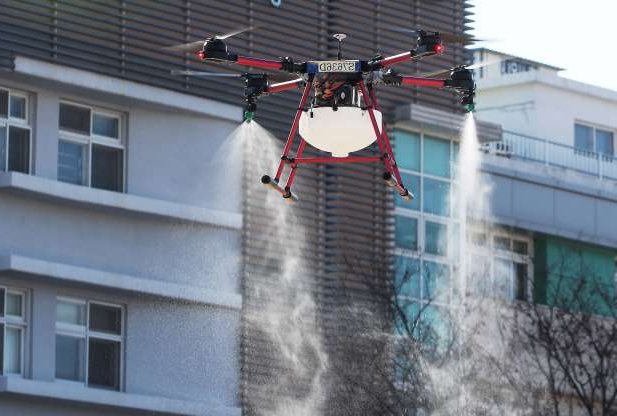 Slide 1 of 50: Photo by YONHAP/EPA-EFE/Shutterstock (10559272a) A drone operated by the Suwon municipal government flies around Changyong Middle School spraying disinfectant, in Suwon, South Korea, 18 February 2020. The disease caused by the novel coronavirus (SARS-CoV-2) has been officially named COVID-19 by the World Health Organization (WHO). The outbreak, which originated in the Chinese city of Wuhan, has so far killed more than 1,800 people with over 73,000 infected worldwide, mostly in China. Preventative measures against coronavirus outbreak in South Korea, Suwon - 18 Feb 2020