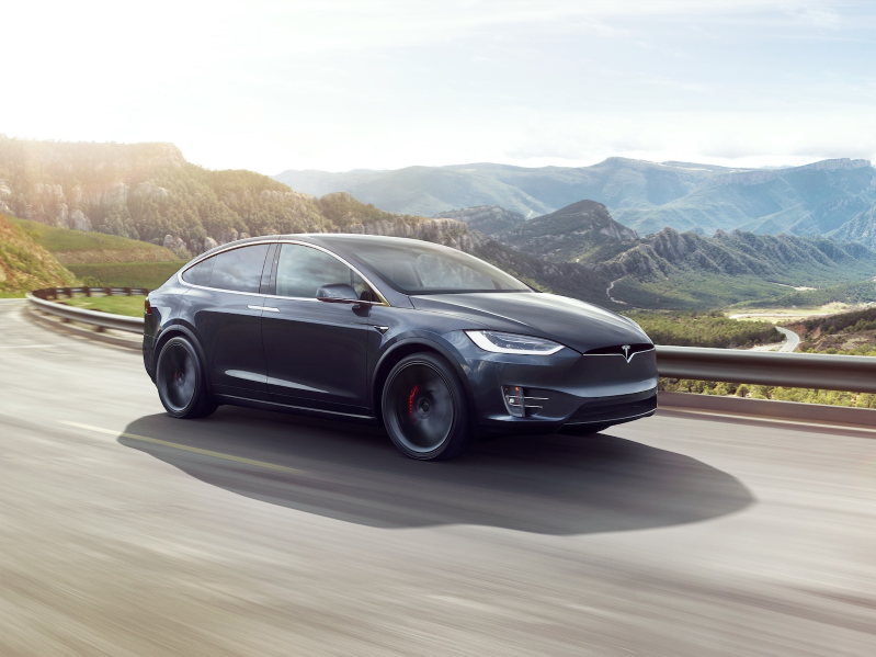 a car parked on the side of a mountain road: McAfee researchers were able to trick a Tesla's autonomous systems.