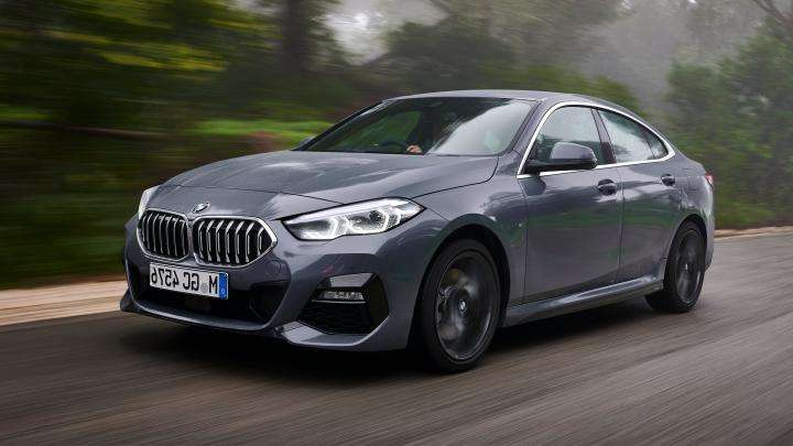 a car parked on the side of a road: BMW 2 Series Gran Coupe saloon front 3/4 tracking