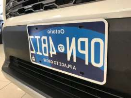 a sign on the side of a car: Ontario's new licence plates went into circulation in Feb. 1. The City of Toronto says its photo radar cameras are having trouble reading the jurisdiction name on the new plates. Above, a mock version of the new plate.