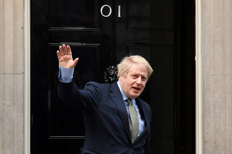 Boris Johnson standing in front of a mirror posing for the camera: Officials said the tweet from Johnson's office was received 'very negatively' in Brussels