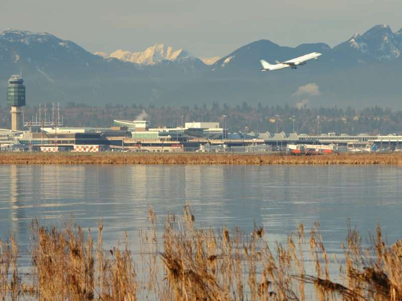 a body of water with a mountain in the background: Last April 16, Jose Barba-Ruiz was detained by the Canada Border Services Agency at Vancouver International Airport after arriving on a flight from Mexico.