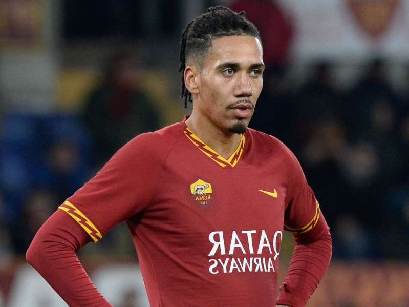 Chris Smalling holding a ball: Chris Smalling is enjoying his time at Roma