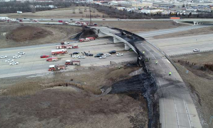 Slide 1 of 7: The ramp from I-465 southbound to I-70 eastbound is pictured Thursday afternoon after a tanker truck carrying about 4,000 gallons of jet fuel overturned and exploded, closing lanes for hours.