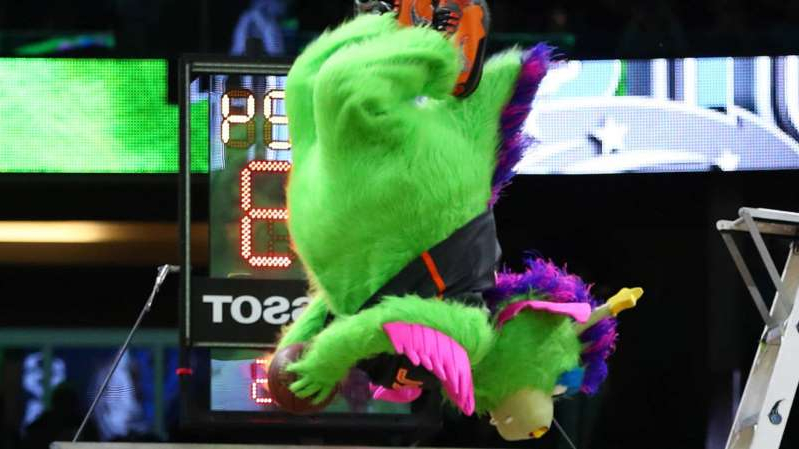 a screen shot of a stuffed animal: Stuff the Magic Dragon just raised the bar for all mascots.