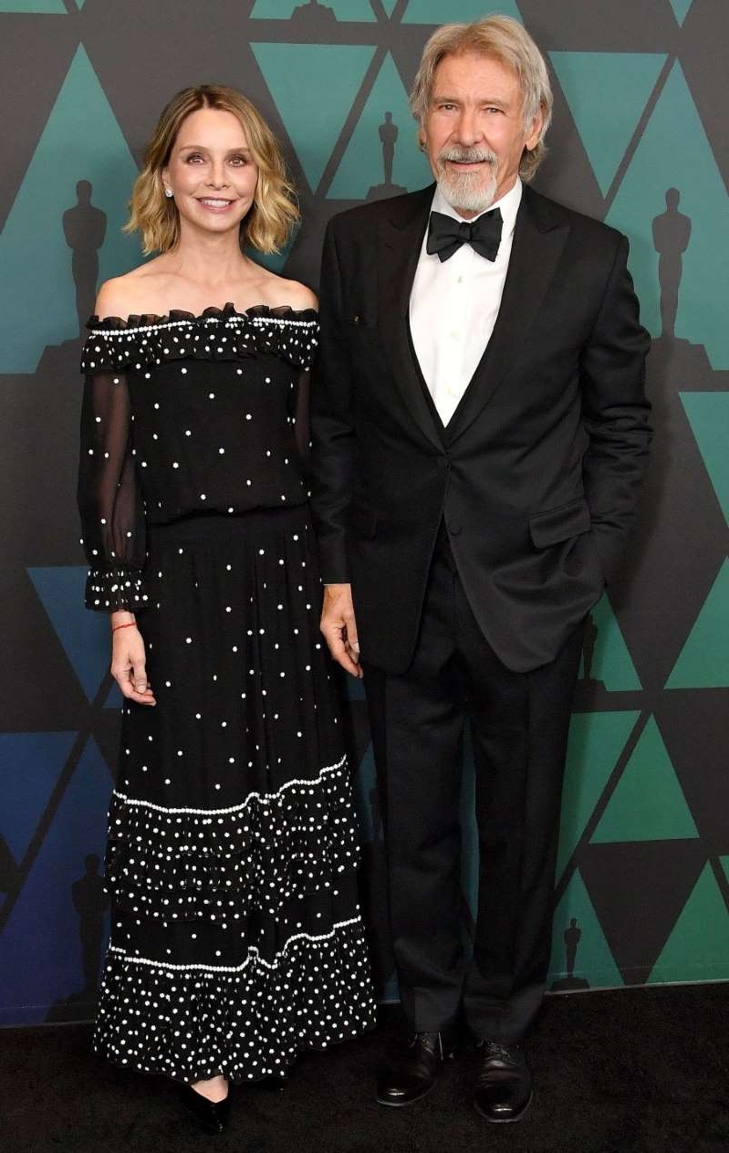 Harrison Ford, Calista Flockhart are posing for a picture: Harrison Ford and Calista Flockhart at The Governors Awards on November 18, 2018 in Los Angeles, California.
