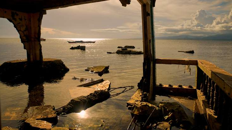a bridge over a body of water: The remains of submerged house in in Batasan in the Philippines.
