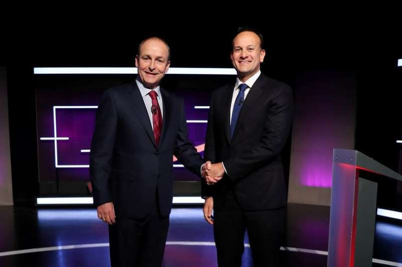 Leo Varadkar, Micheal Martin are posing for a picture: Taoiseach and Fine Gael leader Leo Varadkar and Fianna Fail leader Micheal Martin at the Virgin Media Television Studios for the General Election 2020 debate
