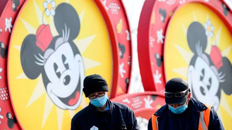 a man in a yellow shirt: A Disney resort in Shanghai has closed over coronavirus fears