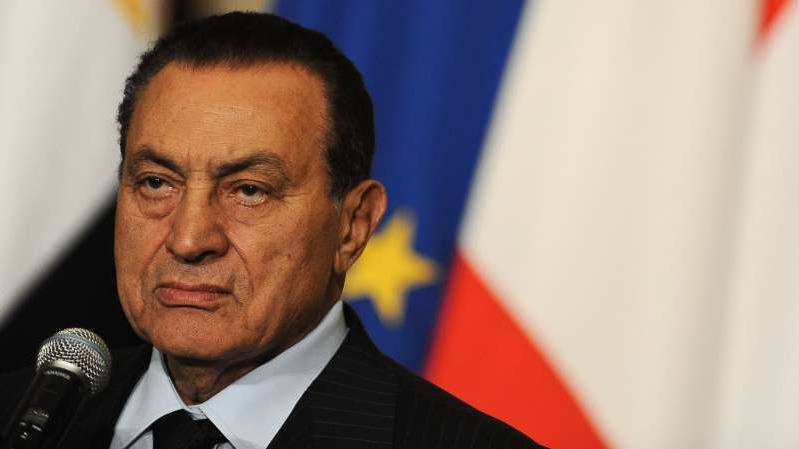 Hosni Mubarak wearing a suit and tie