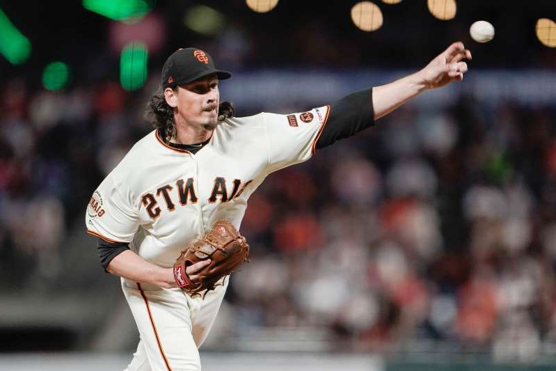 "a baseball player throwing a ball: ""Oh, yeah. Just give me No. 2 and don't make me cut my hair,"" Samardzija joked about landing with the Yankees."