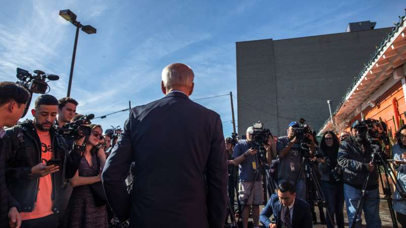 a group of people standing in front of a crowd: Former Vice President Joseph R. Biden Jr. spoke outside of a Mexican restaurant in Los Angeles in December.
