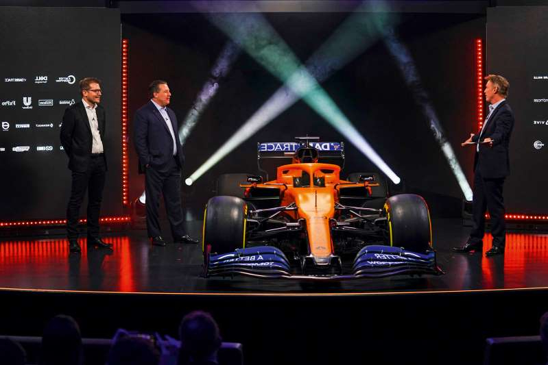 a group of people standing on a stage: McLaren expects another strong showing this season