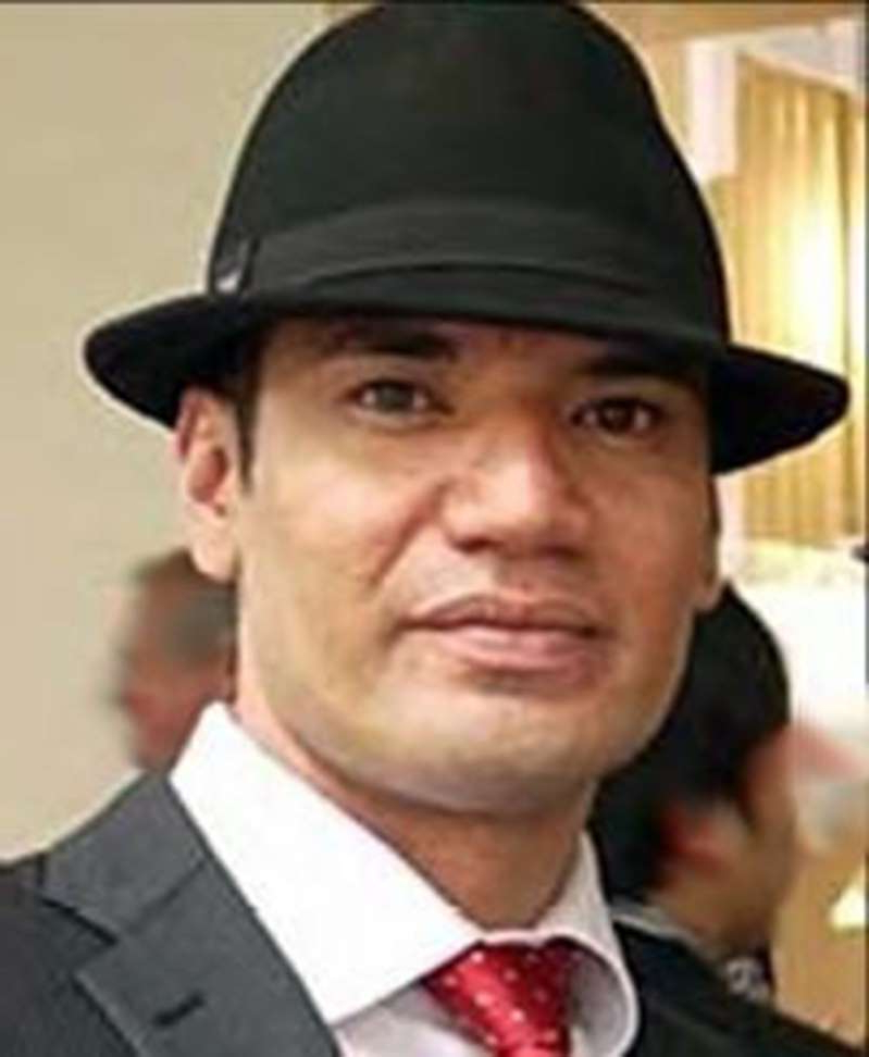 a man wearing a suit and hat: Joel Morehu-Barlow has been deported to New Zealand.