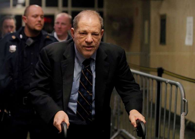 Harvey Weinstein wearing a suit and tie: Harvey Weinstein departs his sexual assault trial at New York Criminal Court in the Manhattan borough of New York City, Jan. 24, 2020.