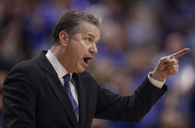 John Calipari wearing a suit and tie: On February 4, 2020, Kentucky head coach John Calipari calls out during a game against Mississippi State at Rupp Arena in Lexington, Ky.
