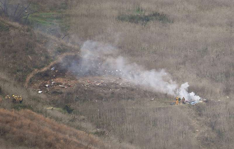 a lot of smoke around it: The crash site of the helecopter Kobe Bryant was in on Sunday, Jan 26, 2020 in Calabasas, Calif. Attorneys for Vanessa Bryant filed a wrongful death lawsuit against the company that operated the helicopter that crashed and claimed the lives of her husband, daughter and seven other people.